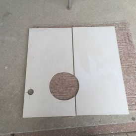 View of a cutout piece lying on the floor