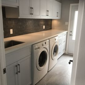 side view of washing and storage cabinets