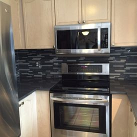 kitchen appliances placed in cabinets