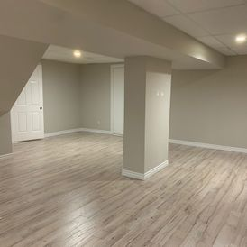 basement with wooden flooring