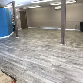 view of fresh flooring in a hall