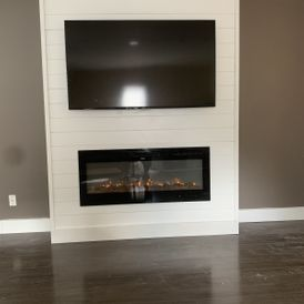 view of a fireplace with a TV